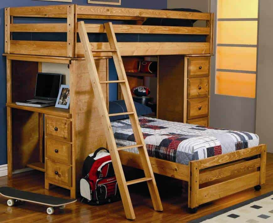 Mountain style boys' bedroom with space-saving bunk bed, polished wood flooring, custom cabinets and navy blue and gray wall paint.