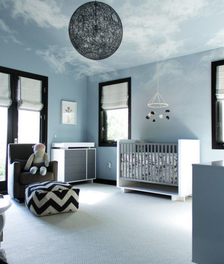 Contemporary dreamland nursery bedroom with rug and elegant-looking pendant light.