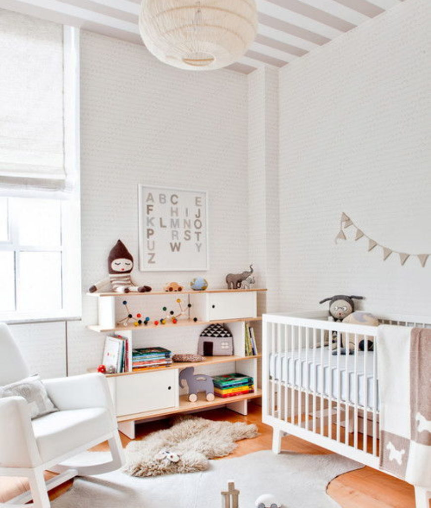 Contemporary small nursery bedroom with white walls and hardwood flooring.