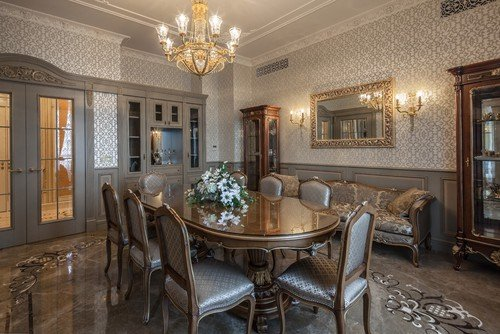 Example of an ornate enclosed dining room design with gray walls