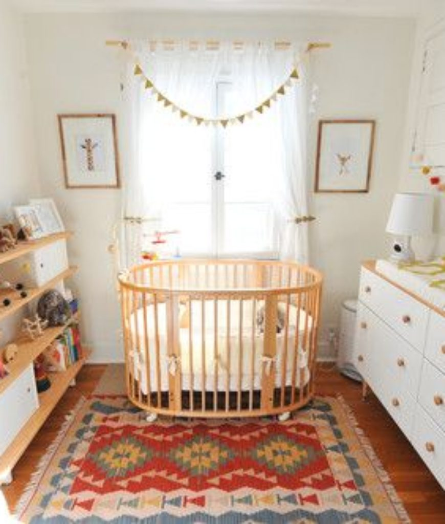 Scandinavian nursery bedroom with white walls and beautiful freestanding shelving.