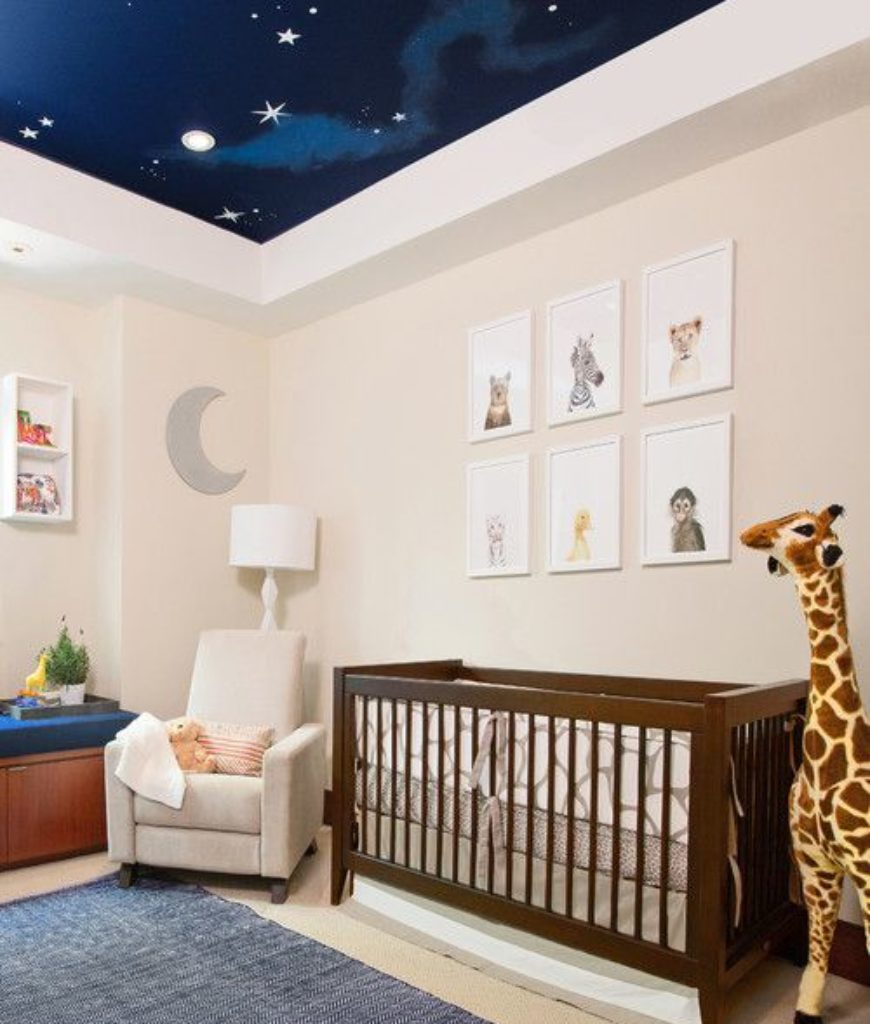 Transitional night sky nursery bedroom with white walls and tray ceiling.