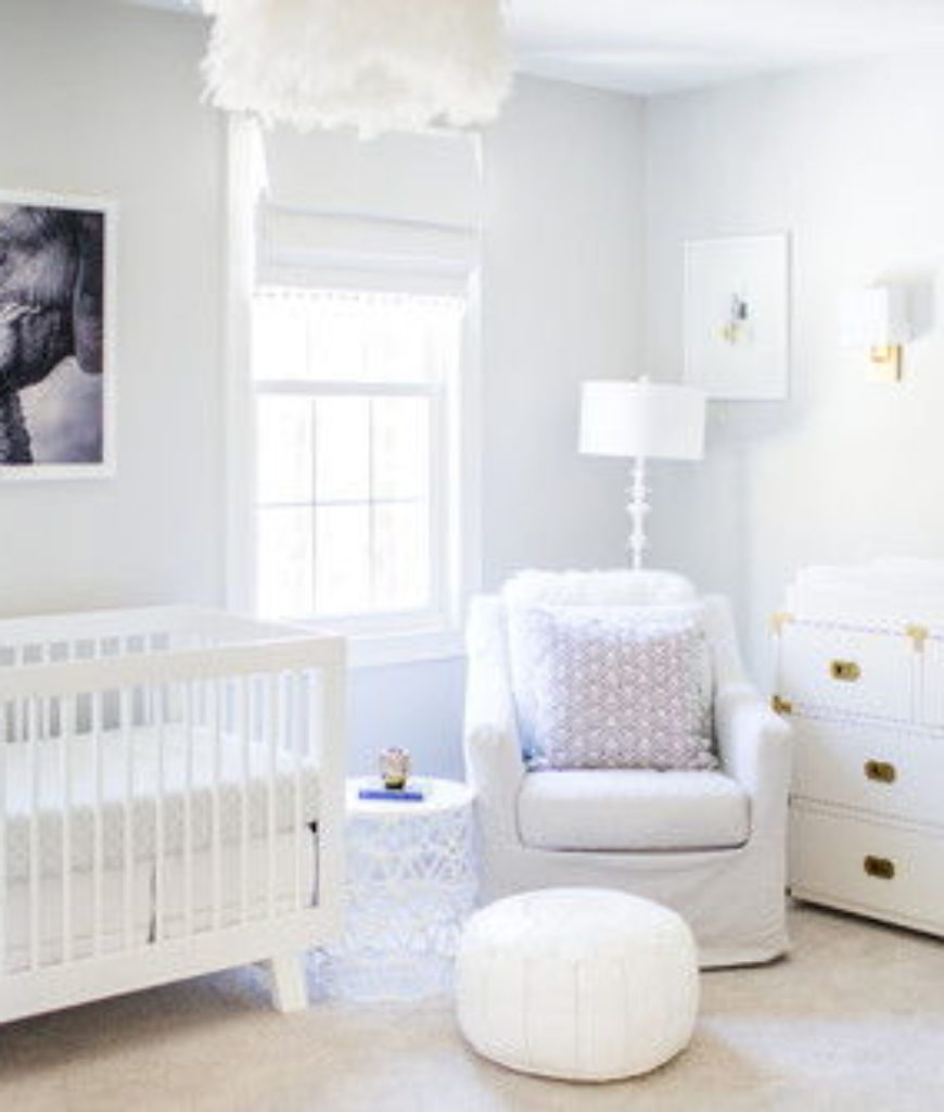Transitional pure white nursery bedroom with carpet flooring and small window.