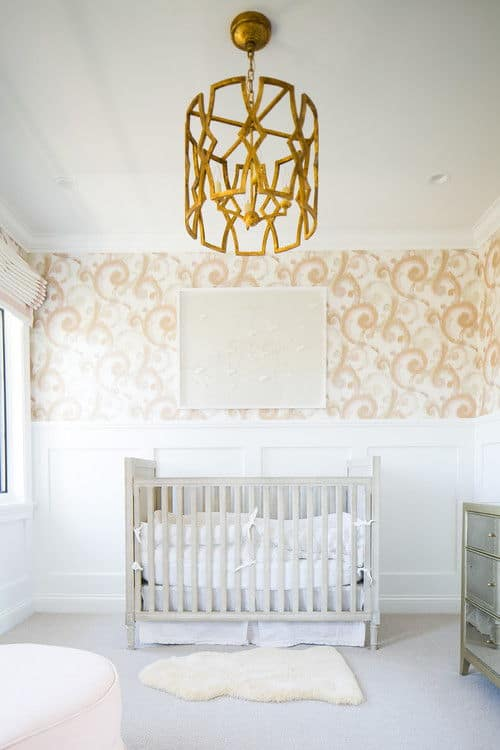 Transitional small nursery bedroom with gold-painted pendant light and carpet flooring.