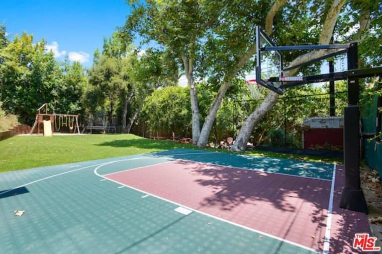 Alanis Morissette's pad has an outdoor sports court perfect for recreational activities.