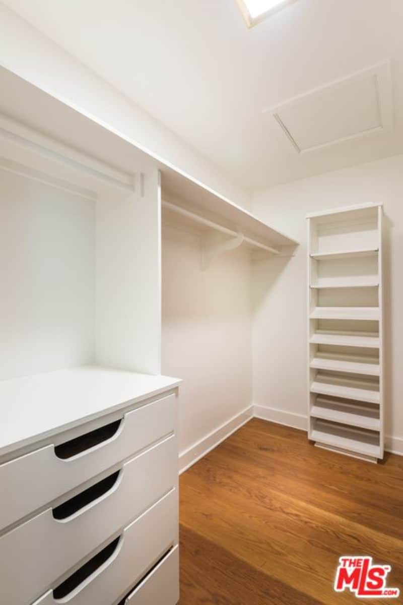 beck and marissas small white closet in hardwood flooring