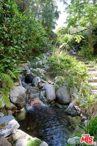 Corden's new home even includes a waterfall and pond as outdoor features.