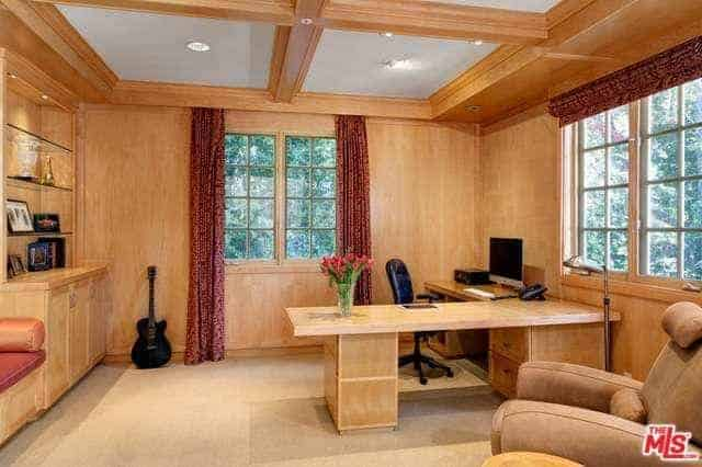 The brown motif for the home office makes the space warm and cozy while one can easily look out to the windows for the green outdoors.