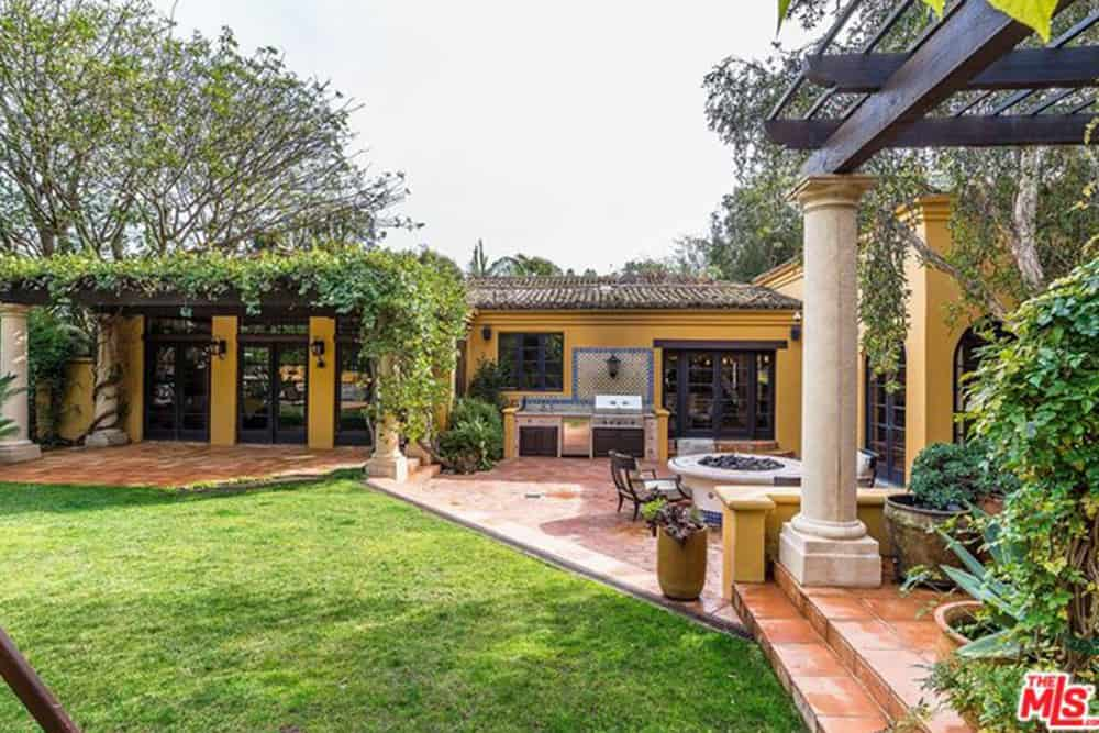 The spacious outdoor includes an outdoor kitchen, an open fire-pit, a sprawling garden and a pergola patio.