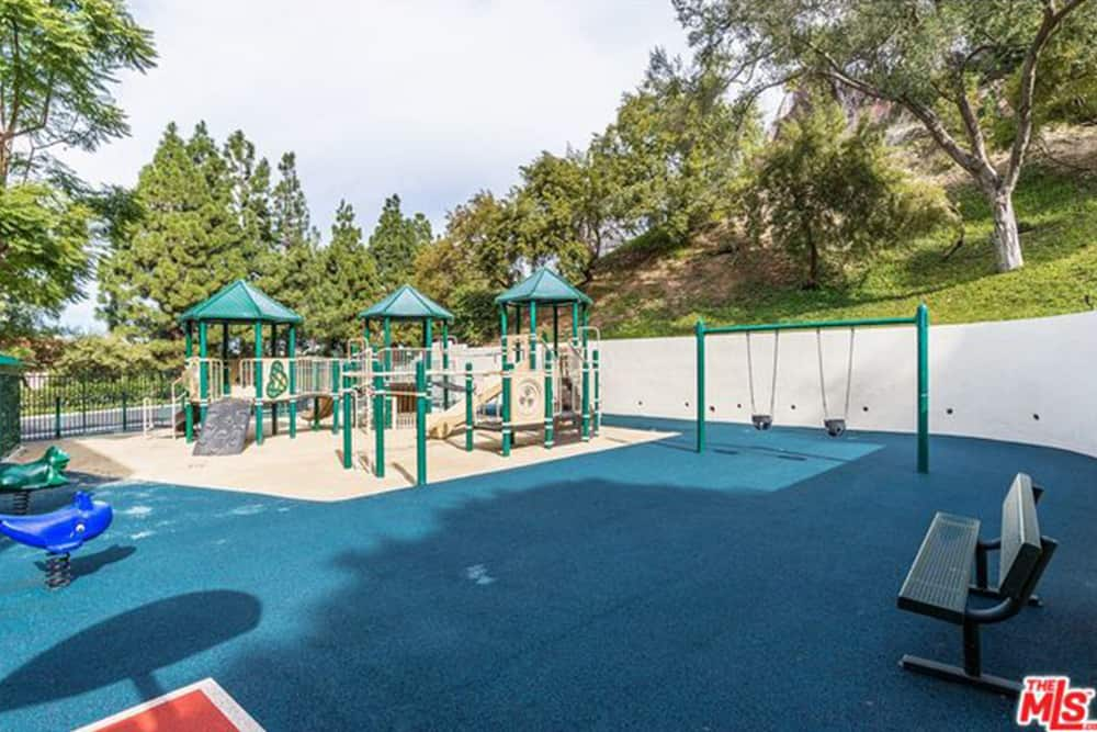 The private property also features another and larger children's playground.