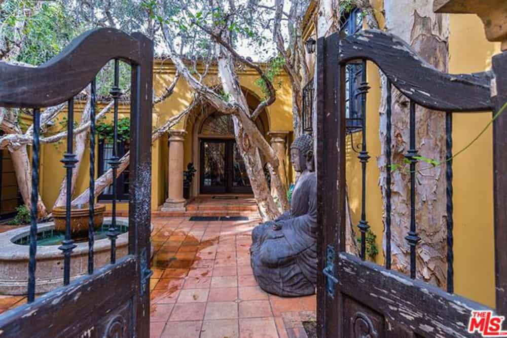 The gated property reveals a glimpse of the Spanish-style estate.