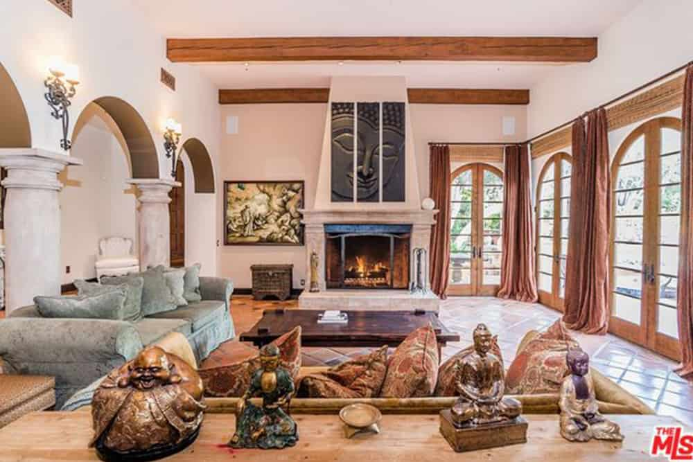 Kendall Jenner's large living room with wood-beamed ceilings.