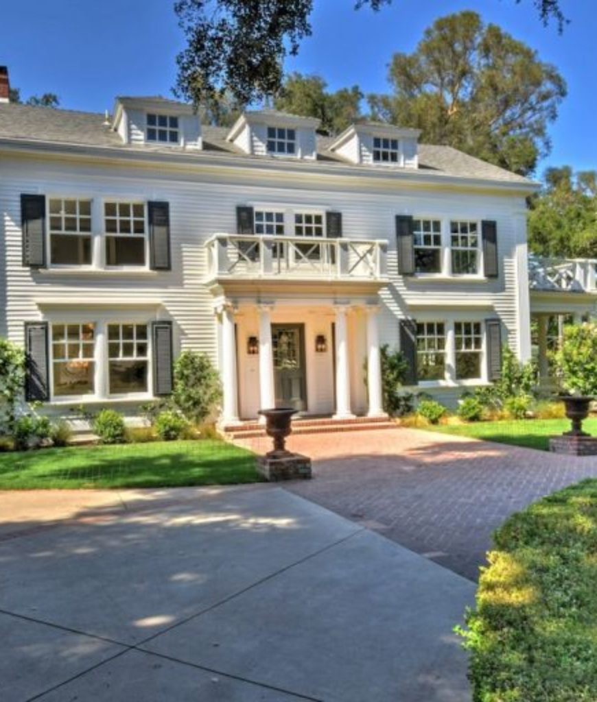 The front view of the classic-style home owned by Kyle Richards and Mauricio Umansky in the sun-drenched San Fernando Valley suburb of Encino.