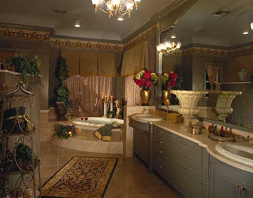 This master bathroom is filled to the brim with elegant details given with a nice background of beige floor tiles and gray walls that blend in with the gray cabinets and drawers of the vanity area.