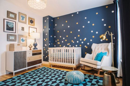 Transitional galaxy gazer nursery bedroom with regular ceiling and white rocking chair.