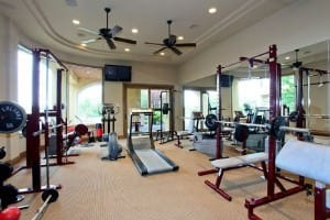 Home gym with recessed lighting.