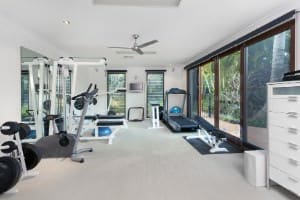 Large home gym with white walls and white ceiling.