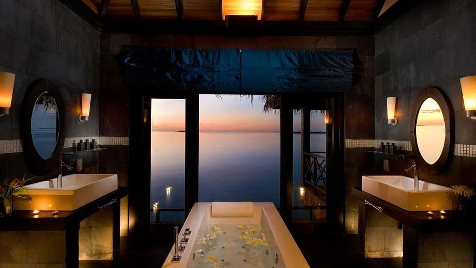Tropical black primary bathroom