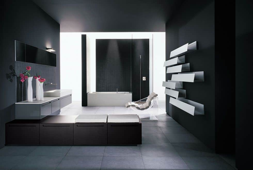 Contemporary primary bathroom featuring stylish black walls and ceiling, along with the gray flooring. The room offers a white floating vanity with a vessel sink along with a freestanding tub.
