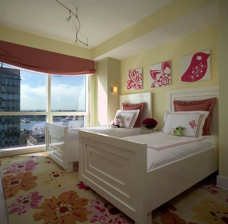 Contemporary kids' bedroom with twin beds and red floral motifs.