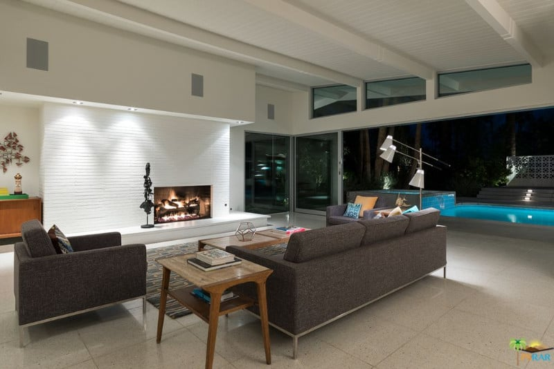 Modish living room featuring a stylish sofa set and fireplace set on the tiles flooring.