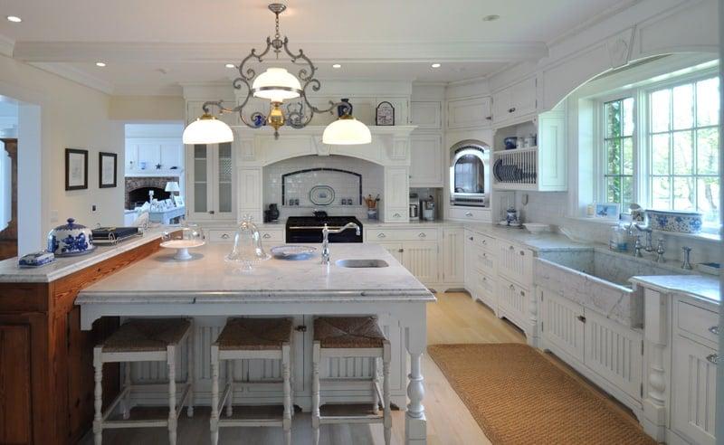 Katharine Hepburn's kitchen has white marble counters, custom cabinets, a Sub-Zero refrigerator and an AGA stove.