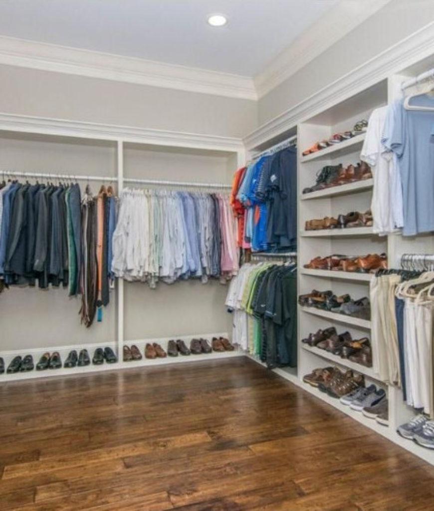 Lucerna large walk-in closet with hardwood flooring.