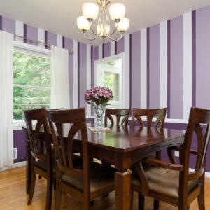 Light hardwood floor and a rectangle dining table