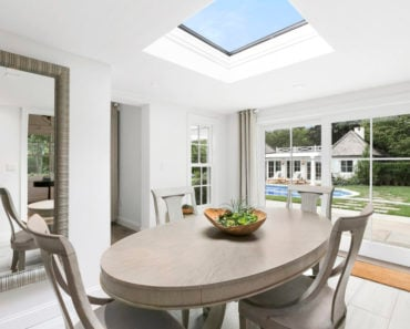 Rachael Ray's dining area with skylight window that brings in beautiful natural light.