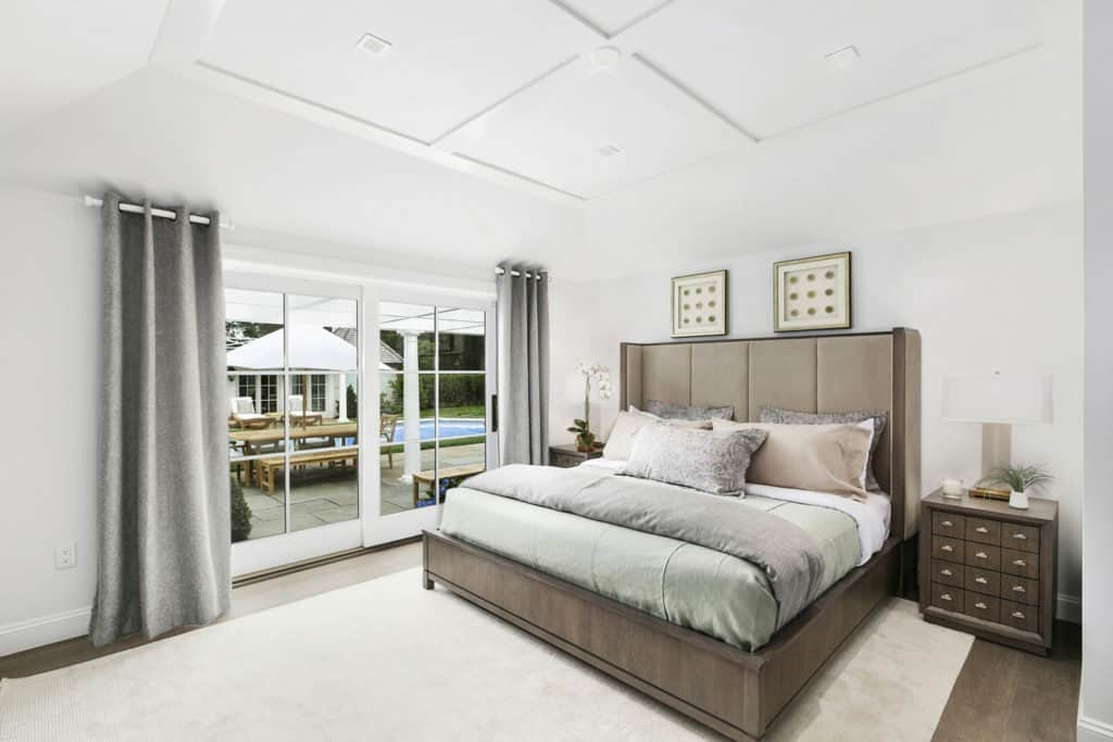 Master Bedroom Area Rugs Part - 31: One Of The Bedrooms Of The Mansion With A White Rug That Complements The  White Walls