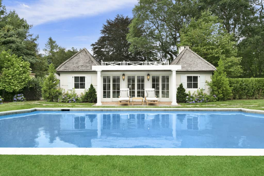 Rachael Ray's property's gunite pool is simple yet beautiful and the white shed is cozy.