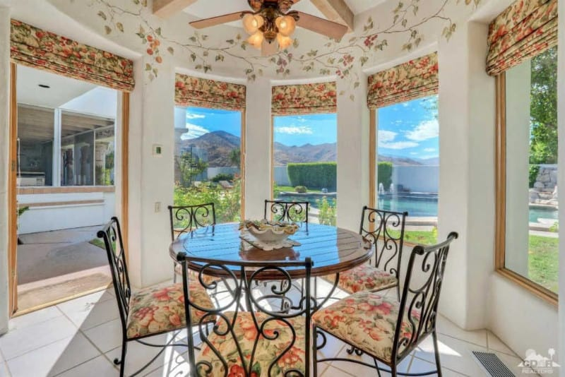 A Mediterranean type of sunroom in a floral aesthetic.