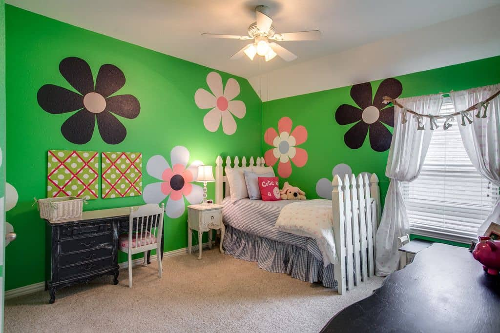 Traditional kids' bedroom with ceiling fan light and carpet flooring.