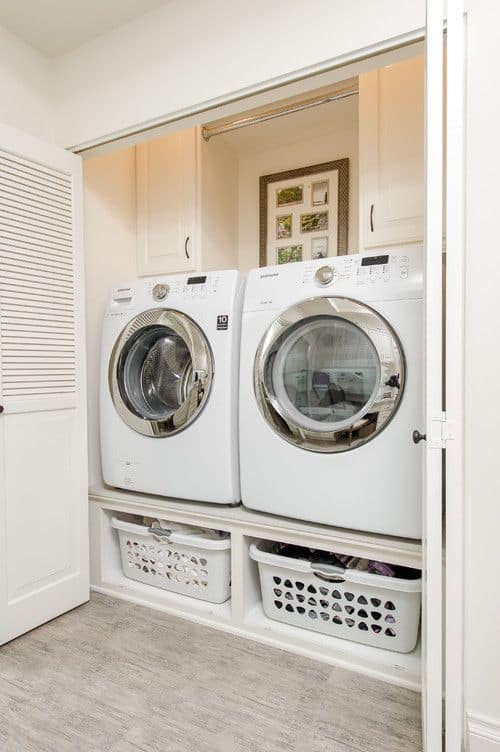 Small Closet Laundry Room With Side By Side Washer And Dryer.