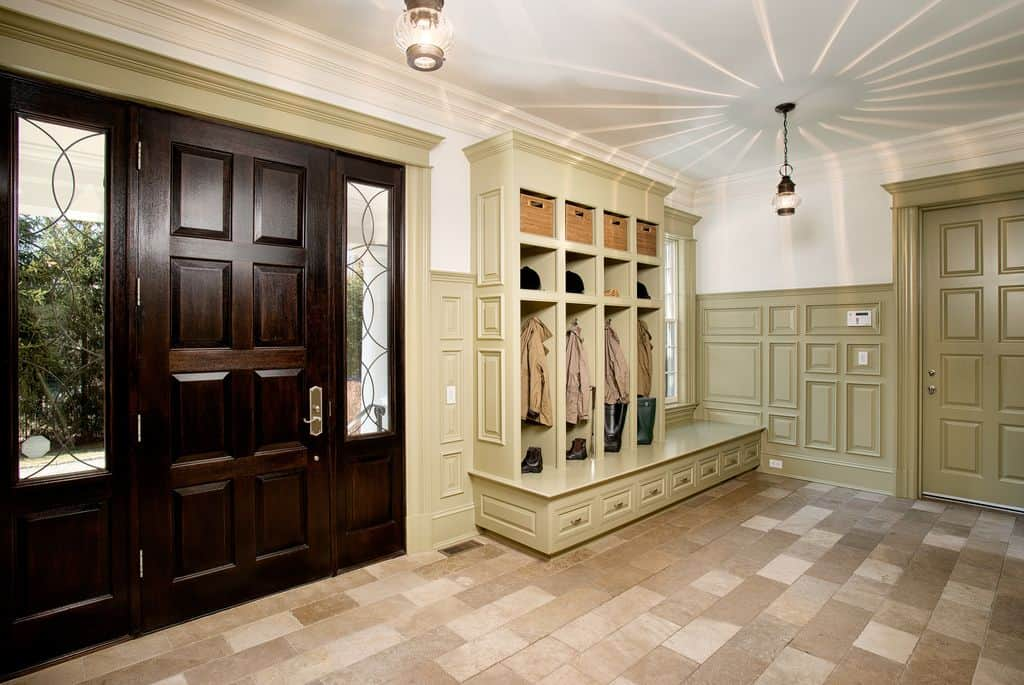 Traditional Mud Room With Tile Flooring Crown Molding And Pendant Lights
