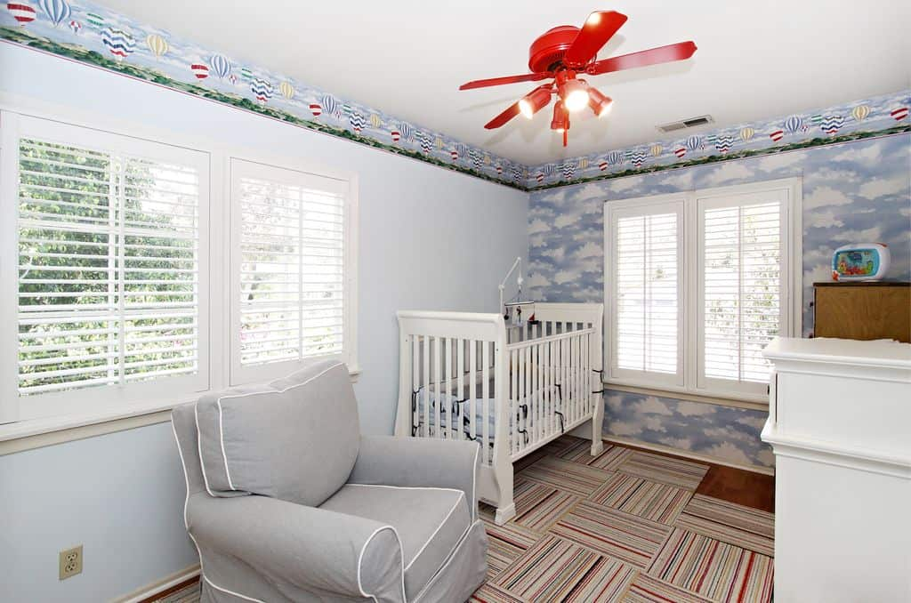 traditional nursery with mural and interior wallpaper