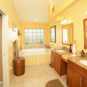 Contemporary yellow primary bathroom