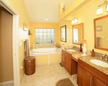 contemporary yellow master bathroom