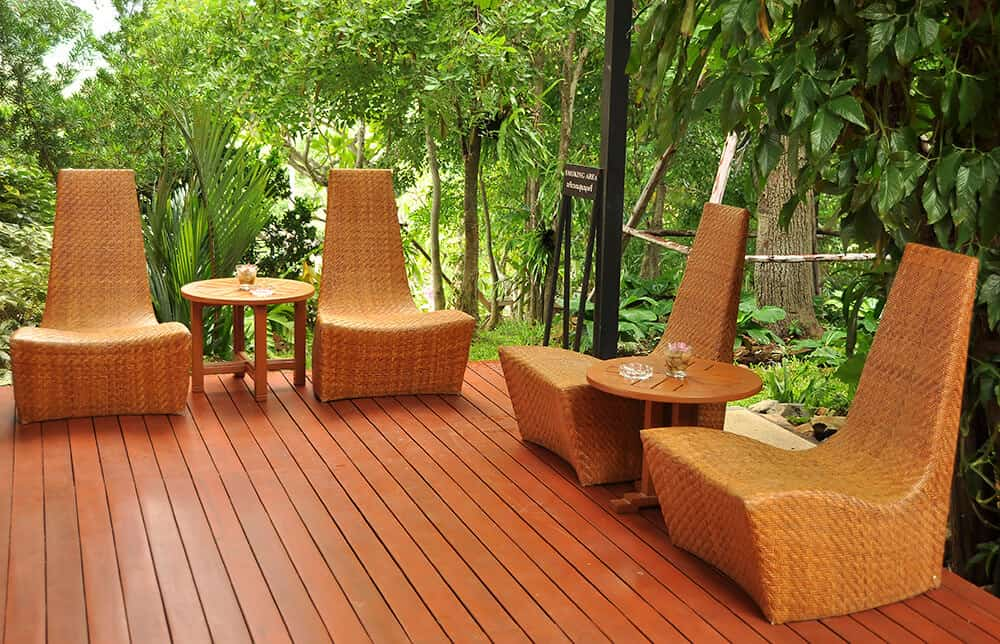 Large wooden deck surrounded by trees.