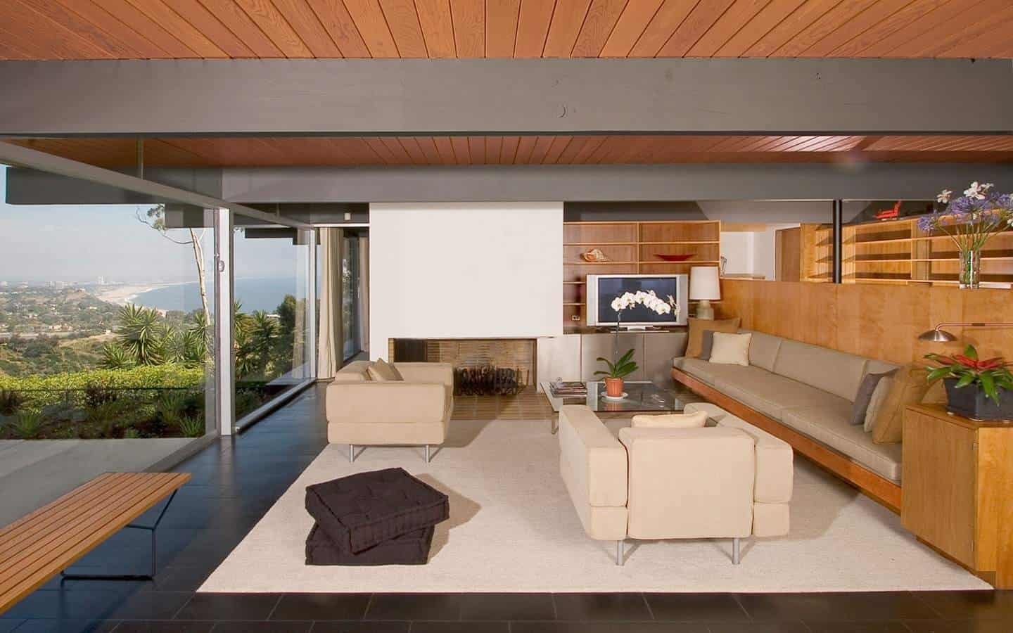 Modern living room with dark tile flooring.