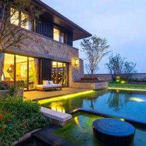 Home with beautiful backyard lighting