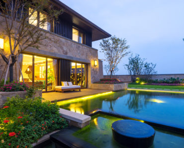 Home with beautiful backyard lighting
