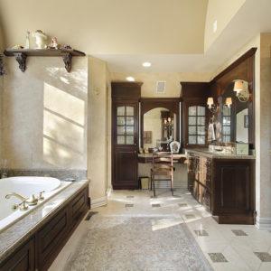 Luxury primary bathroom with custom woodwork