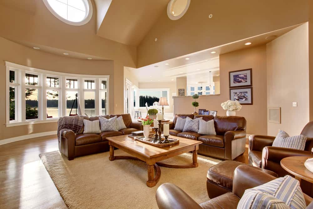 Living room with asymmetrical vaulted ceiling.