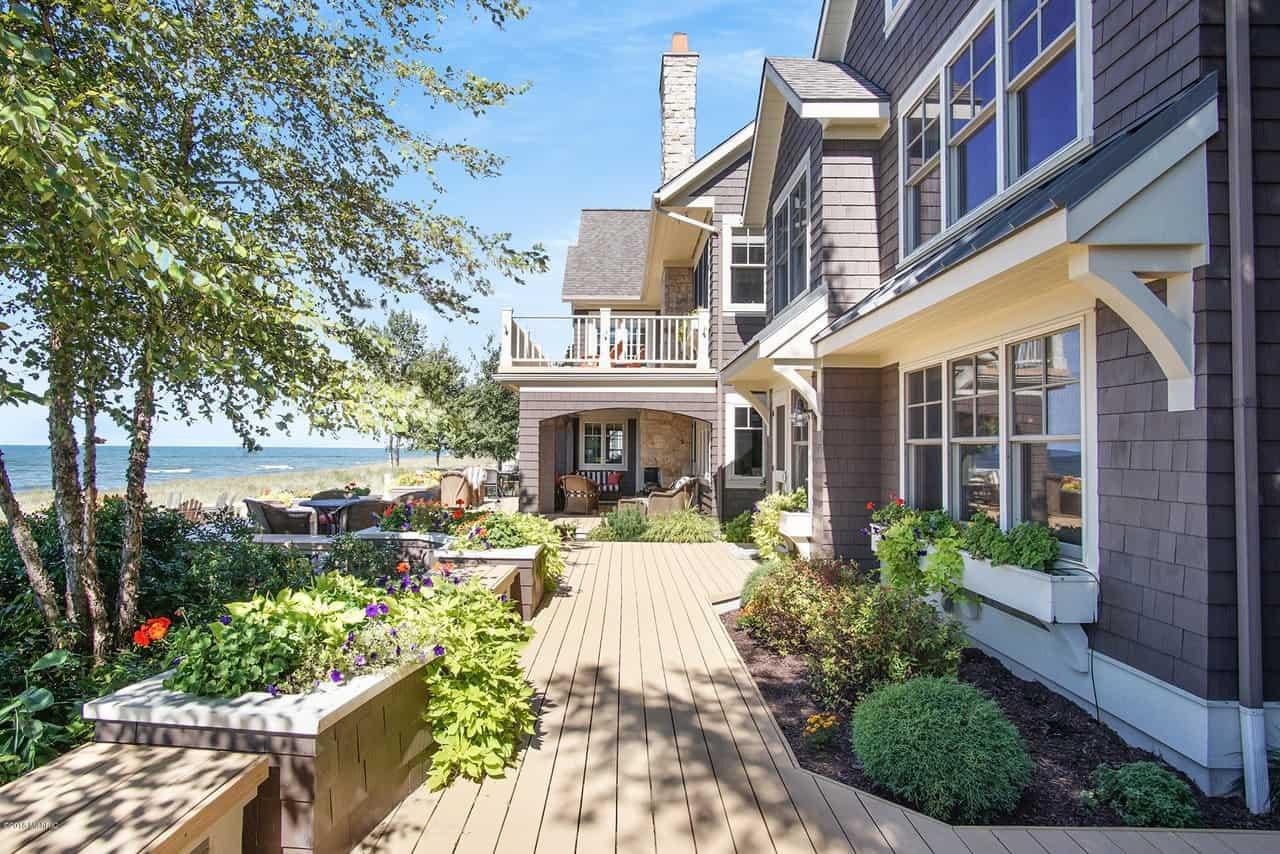 Long wood walkway at rear of beach house mansion on Lake Michigan