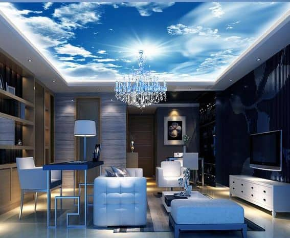 Modern living room with bright custom blue sky photo ceiling with some clouds.