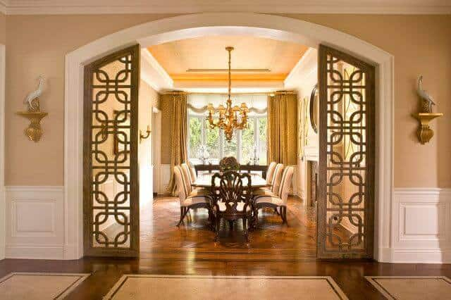 An elegant dining room with an enormous archway and a tray ceiling trimmed in Flex Trim.