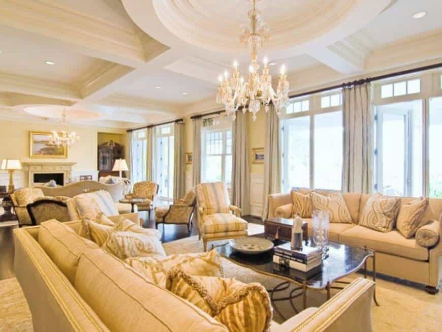 Elegant living room with coffered ceilings and a small dome on the left side of the room.