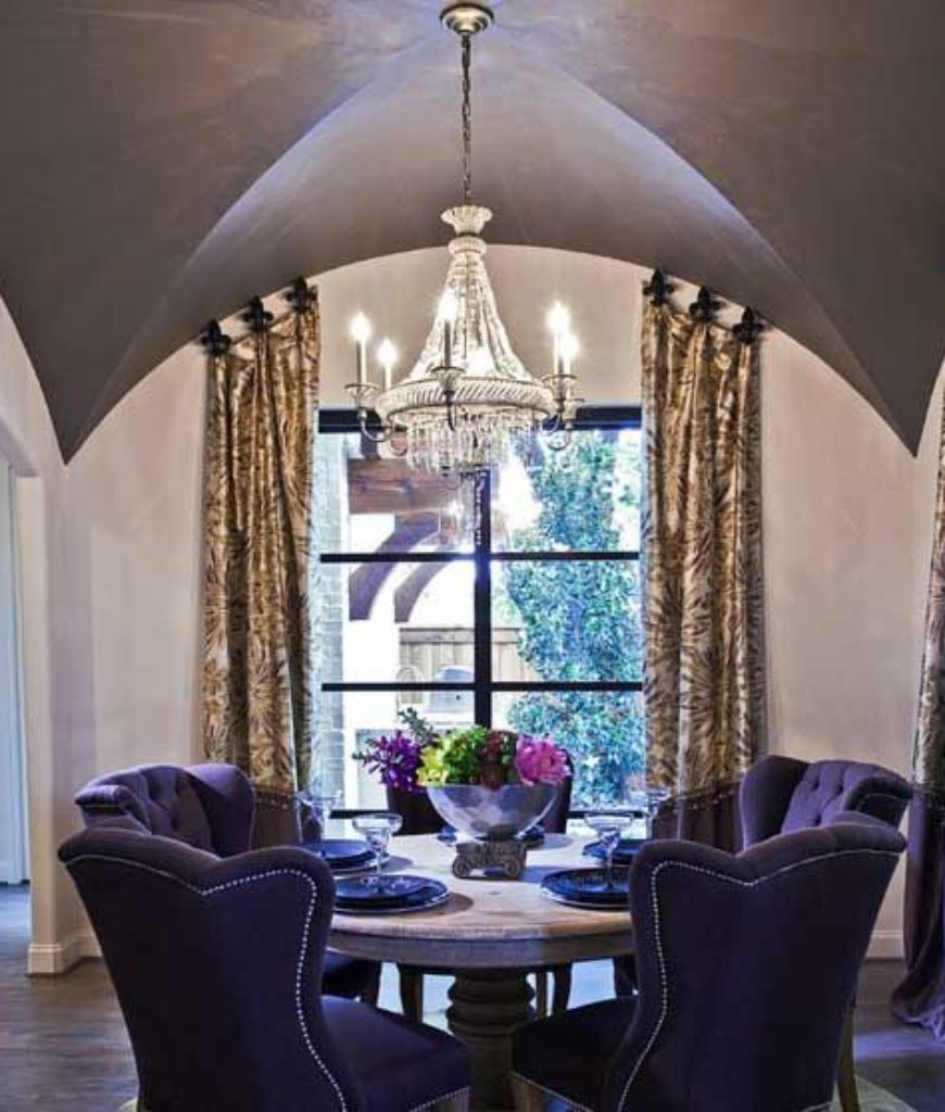 The steep groin vault over this small purple dining area adds an extra flair of drama.
