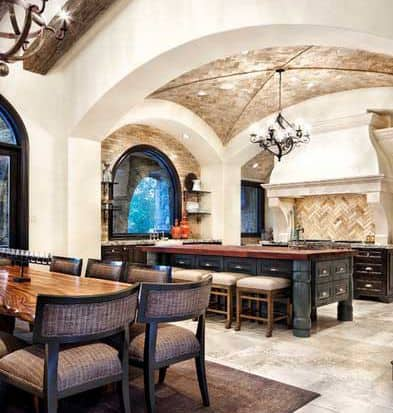 Exposed wood beams in the dining room are matched by an equally impressive stone groin arch in the kitchen.